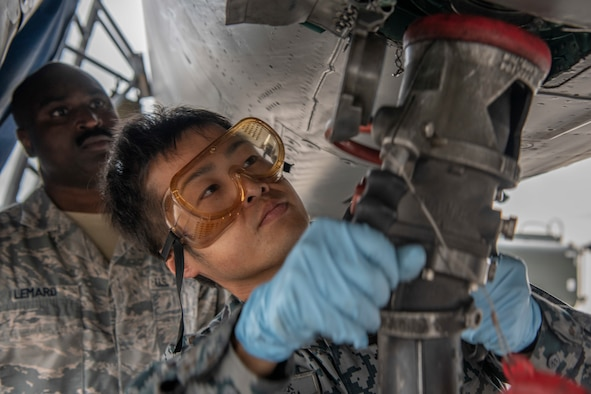 Japanese Self-Defense Force Staff Sgt. Shuichiro Masunaga, 6th Tactical Fighter Squadron aircraft general technician, right, trains on refueling an F-15C Eagle with guidance from, U.S. Air Force Tech. Sgt. Adrian Lemard,18th Aircraft Maintenance Squadron crew chief, left, as part of an NCO Bilateral Exchange program Nov. 19, 2019, at Kadena Air Base, Japan. Bilateral exchanges allow for a better understanding of the capabilities held by each countries Armed Forces, as well as the opportunity to improve relations between the United States and Japan. (U.S. Air Force photo by Senior Airman RhettI sbell)