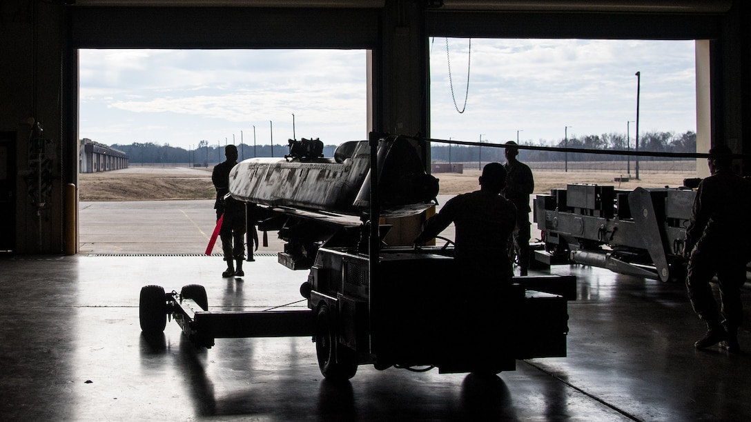 Airmen from the 2nd Munitions Squadron transport the final Conventional Air-launched Cruise Missile (CALCM) to be demilitarized at Barksdale Air Force Base, La., Nov. 20, 2019. The CALCM missile package was first operationally used in 1991 during Operation Secret Squirrel. (U.S. Air Force photo by Airman 1st Class Jacob B. Wrightsman)