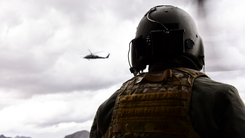 Airmen watches a helicopter fly
