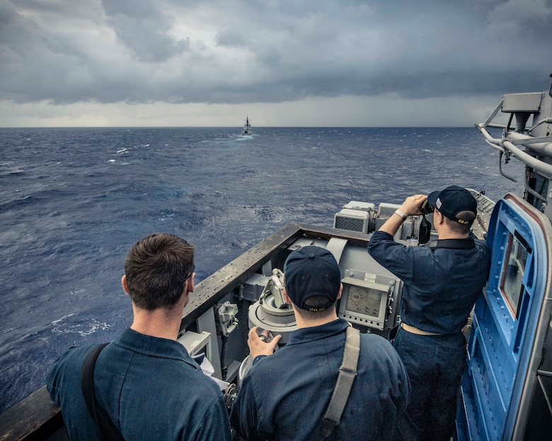 PHILIPPINE SEA (Nov. 21, 2019) Sailors stand watch on the bridge of the Ticonderoga-class guided-missile cruiser USS Chancellorsville (CG 62) as the ship maneuvers behind the Royal Australian navy ship HMAS Hobart (DDG 39) during a group maneuvering exercise with ships from the Royal Australian Navy, Royal Canadian Navy, and Republic of Korea Navy as part of Pacific Vanguard 2019. Chancellorsville is forward-deployed to the U.S. 7th Fleet area of operations in support of security and stability in the Indo-Pacific region.