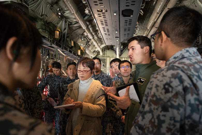 1st Lt. Christopher Gull, 36th Airlift Squadron C-130J Super Hercules pilot and standards and evaluations officer, explains the capabilities of a C-130J to Japanese Air Self-Defense Force Lieutenants during a basic maintenance officer tour at Yokota Air Base, Japan, Nov. 21, 2019