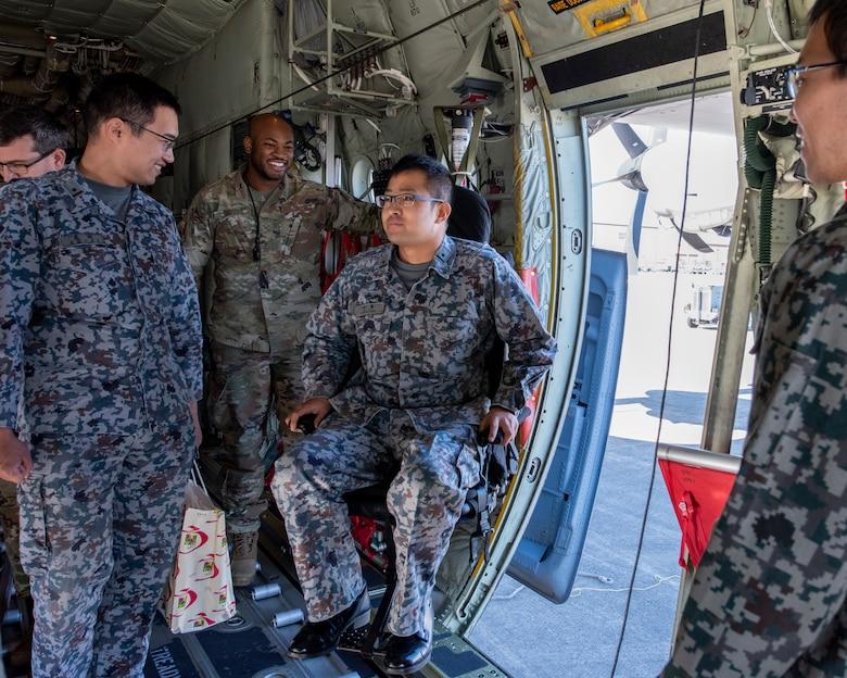 A Japanese Air Self-Defense Force Lieutenant sits in a loadmaster's crash-worthy seat on a C-130J Super Hercules during a basic maintenance officer tour at Yokota Air Base, Japan, Nov. 21, 2019.
