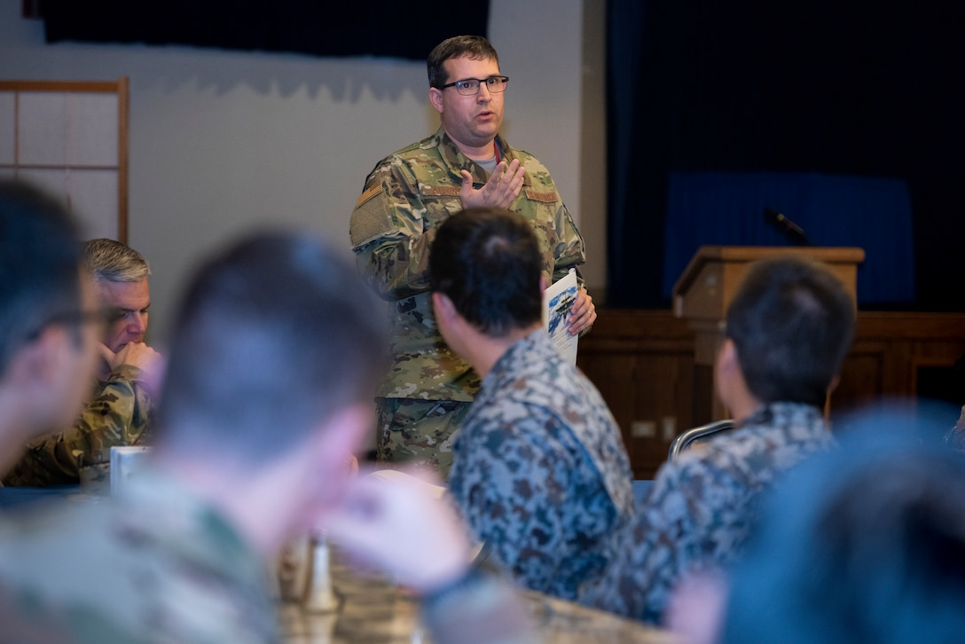 U.S. Air Force Capt. Christopher Alfonso, maintenance exchange officer assigned to the Japanese Air Self-Defense Force's First Technical School at Hamamatsu Air Base, Japan, briefs 374th Maintenance Group members during a basic maintenance officer tour at Yokota Air Base, Japan, Nov. 21, 2019.