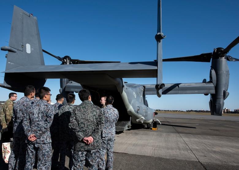 Japanese Air Self-Defense Force Lieutenants tour a CV-22 Osprey during a basic maintenance officer tour at Yokota Air Base, Japan, Nov. 21, 2019.