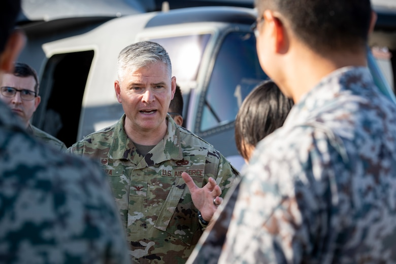 Col. Todd Wydra, 374th Maintenance Group commander, answers a question from a Japanese Air Self‐ Defense Force Lieutenant during a basic maintenance officer tour at Yokota Air Base, Japan, Nov. 21, 2019.