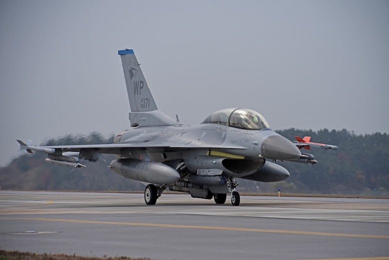 "A U.S. Air Force F-16 Fighting Falcon assigned to the 35th Fighter Squadron taxis down the flightline at Kunsan Air Base, Republic of Korea, Nov. 19, 2019. The 35th FS ""Pantons"" perform air and space control roles including counter air, strategic attack, interdiction and close-air support missions. (U.S. Air Force photo by Staff Sgt. Mackenzie Mendez)"