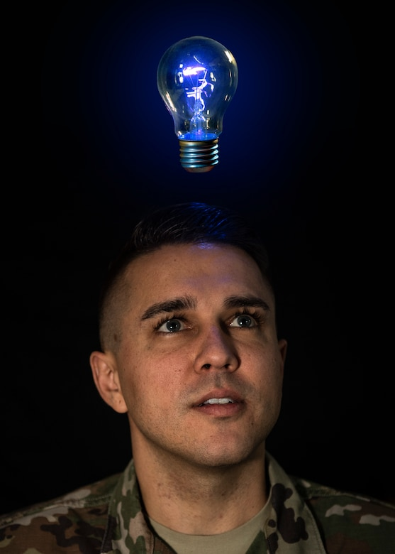 U.S. Air Force Staff Sgt. Preston Cherry, 52nd Fighter Wing Public Affairs photojournalist, poses for a photo illustration at Spangdahlem Air Base, Germany, Nov. 22, 2019. Airmen who have innovative ideas of how to better their workplace can contact the 52nd Innovation and Transformation Office. The ITO team teaches Airmen about continual process improvement, which can improve productivity and morale. (U.S. Air Force photo illustration by Airman 1st Class Valerie Seelye)