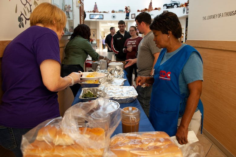 A photo of volunteers serving food during a Thanksgiving meal.