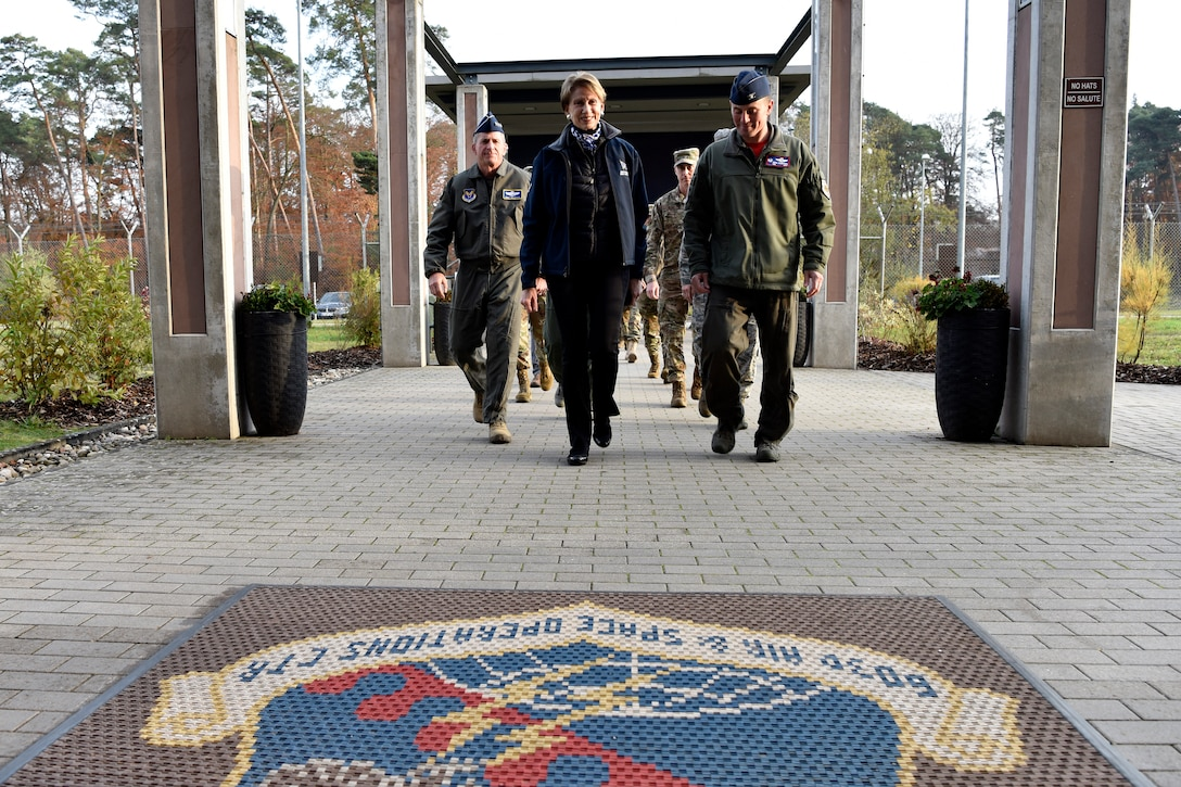 Secretary of the Air Force Barbara M. Barrett (center), U.S Air Force Chief of Staff Gen. David L. Goldfein, and Col. Cary Culbertson, 603rd Air Operations Center commander, walk towards the AOC during a base visit at Ramstein Air Base, Germany, Nov. 22, 2019.