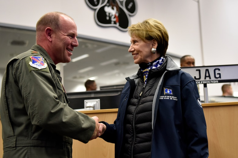 U.S. Air Force Maj. Kevin Edwards, U.S. Air Forces in Europe and Air Forces Africa joint interface control officer, receives a coin from Secretary of the Air Force Barbara M. Barrett during a tour of the 603rd Air and Space Operations Center at Ramstein Air Base, Germany, Nov. 22, 2019.