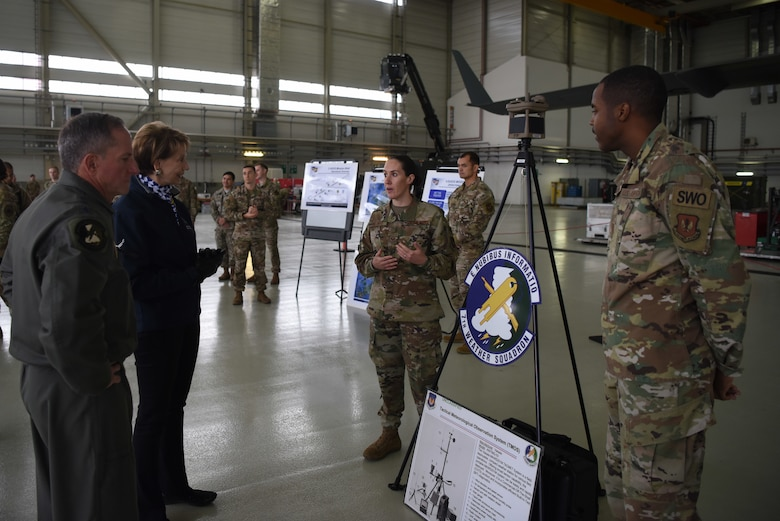 Members of the 7th Weather Squadron discuss micro weather systems employment with Air Force Chief of Staff Gen. David L. Goldfein and Secretary of the Air Force Barbara Barrett.