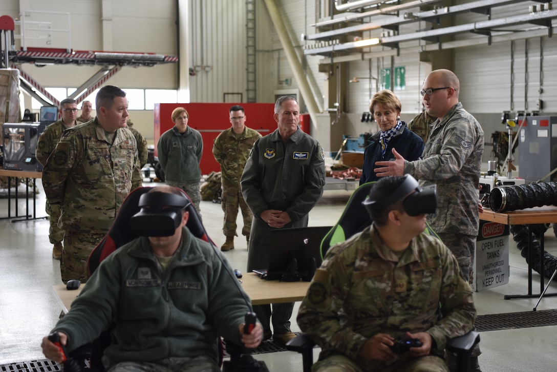 Members of 721st Maintenance Squadron discuss new training tactics with Air Force Chief of Staff Gen. David L. Goldfein and Secretary of the Air Force Barbara Barrett during a tour on Ramstein Air Base, Germany, Nov. 22, 2019.