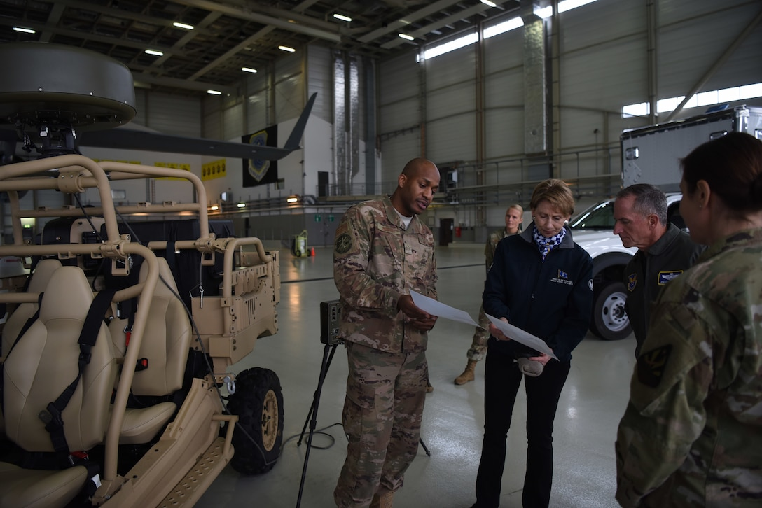 U.S. Air Force Staff Sgt. Sean Scott, 435th Air Ground Operations Wing, radar air and weather systems NCO, explains the equipment and procedures of the deployable air traffic control and landing systems to Air Force Chief of Staff Gen. David L. Goldfein and Secretary of the Air Force Barbara Barrett during briefing on Ramstein Air Base, Germany, Nov. 22. 2019.