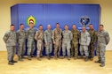 Members of the Michigan Air National Guard and the Latvian Air Force pose Nov. 15, 2019 after a planning meeting at Lielvārde Air Base, Latvia, to chart cooperation under the National Guard Bureau's State Partnership Program over the coming year (Michigan National Guard Photo by Staff Sgt. Andrew Schumann).