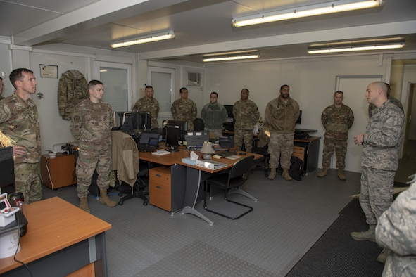 U.S. Air Force Col. David Epperson, 52nd Fighter Wing commander, left, talks with members of the 701st Munitions Support Squadron during his immersion at Kleine Brogel Air Base, Belgium, Nov. 22, 2019. The 701st MUNSS is a Geographically Separated Unit responsible to receive, store and maintain U.S. munitions. (U.S. Air Force photo by Airman 1st Class Branden Rae)
