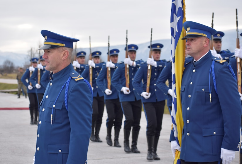 Dressed in blue uniforms, members of the Bosnia-Herzegovina military stand in formation.