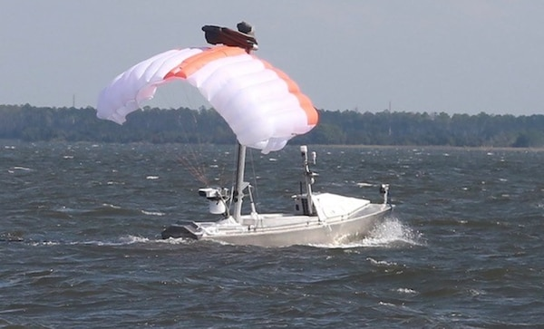 The Towed Airborne Lift of Naval Systems (TALONS) is a parafoil-based system shown kiting from the Greenough Advanced Rescue Craft. TALONS relays data between the MCM USV and the LCS via the government-developed multi-vehicle communication relays system.