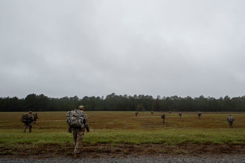 A photo of students of the Air Force Ranger Assessment Course walking in formation