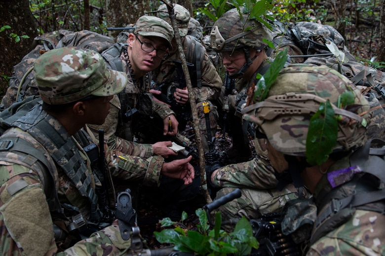 A photo of squad leaders discussing strategy during an Air Force Ranger Assessment Course