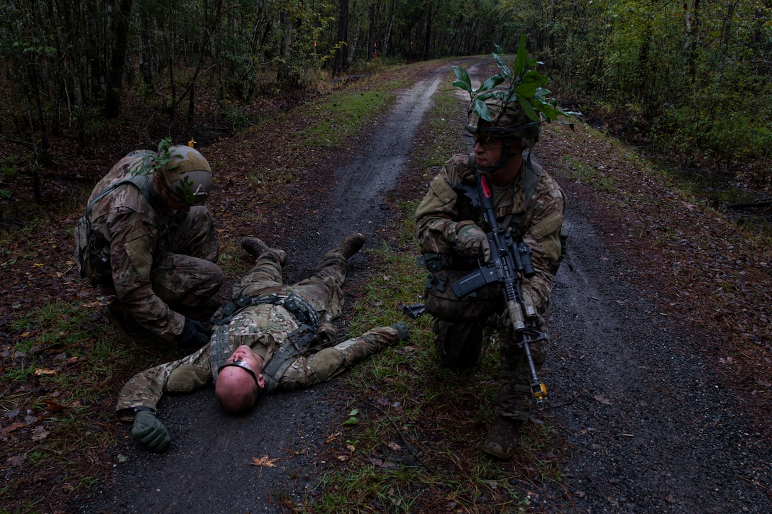 A photo of students of the Air Force Ranger Assessment Course performing a simulated casualty search