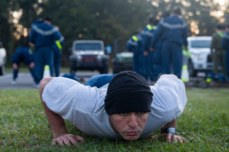 A photo of an Air Force Ranger Assessment Course student performing a push-up