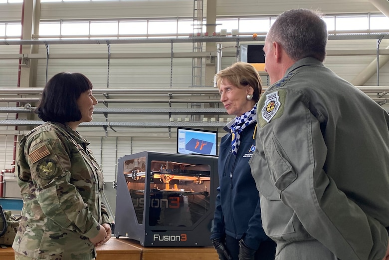 A member of the 721 Aerial Port Squadron shows Air Force Chief of Staff Gen. David L. Goldfein and Secretary of the Air Force Barbara Barrett a three dimensional printer during a tour on Ramstein Air Base, Germany, Nov. 22, 2019.