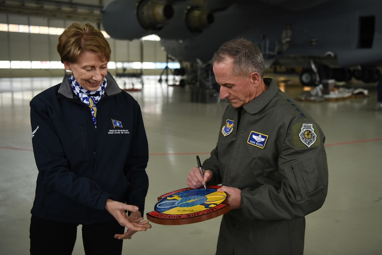 Air Force Chief of Staff Gen. David L. Goldfein and Secretary of the Air Force Barbara Barrett sign a plaque for the 721st Maintenance Squadron during a tour of Ramstein Air Base, Germany, Nov. 22, 2019.