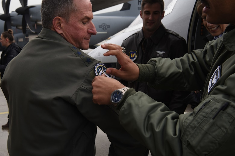 A member of the 86th Aeromedical Evacuation Squadron places a squadron patch on Air Force Chief of Staff Gen. David L. Goldfein after a capabilities brief on Ramstein Air Base, Germany, Nov. 22, 2019.