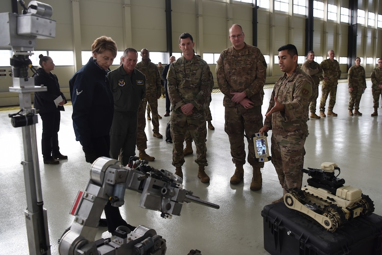Air Force Chief of Staff Gen. David L. Goldfein and Secretary of the Air Force Barbara Barrett listen to a presentation by the 86th Civil Engineer Squadron Explosive Ordnance Disposal unit during a base tour on Ramstein Air Base, Germany, Nov. 22, 2019.