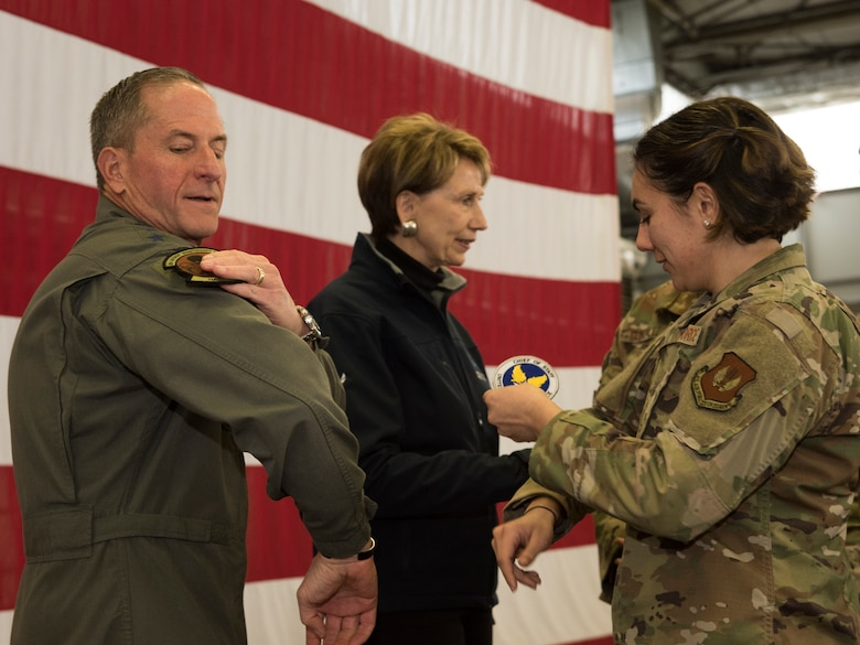 Air Force Chief of Staff Gen. David L. Goldfein trades squadron patches with an Airman after a town hall on Ramstein Air Base, Germany, Nov. 22, 2019.