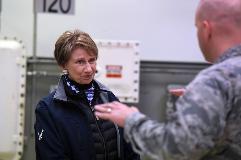 Secretary of the Air Force Barbara M. Barrett receives an overview of the nuclear university training facility from Lt. Col. Eric Golden, U.S. Air Forces in Europe and Air Forces Africa deputy chief of nuclear operations, during a base visit at Ramstein Air Base, Germany, Nov. 22, 2019.