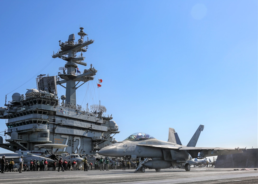 "An F/A-18F Super Hornet attached to the ""Jolly Rogers"" of Strike Fighter Squadron (VFA) 103 launches from the flight deck of the aircraft carrier USS Abraham Lincoln (CVN 72). Abraham Lincoln Carrier Strike Group is deployed to the U.S. 5th Fleet area of operations in support of naval operations to ensure maritime stability and security in the Central Region, connecting the Mediterranean and the Pacific through the western Indian Ocean and three strategic choke points. With Abraham Lincoln as the flagship, deployed strike group assets include staffs, ships and aircraft of Carrier Strike Group 12 (CSG 12), Destroyer Squadron 2 (DESRON 2), USS Leyte Gulf (CG 55) and Carrier Air Wing 7 (CVW 7). (U.S. Navy photo by Mass Communication Specialist 3rd Class Jeremiah Bartelt/Released)"