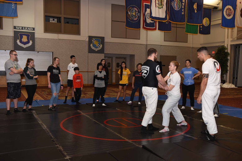 Airmen and families from Team McConnell attend a self-defense class Nov. 23, 2019, at McConnell Air Force Base, Kan. The class provided attendees with safety strategies, physical techniques to successfully escape an attack and psychological awareness. (U.S. Air Force photo by Airman 1st Class Alexi Bosarge)