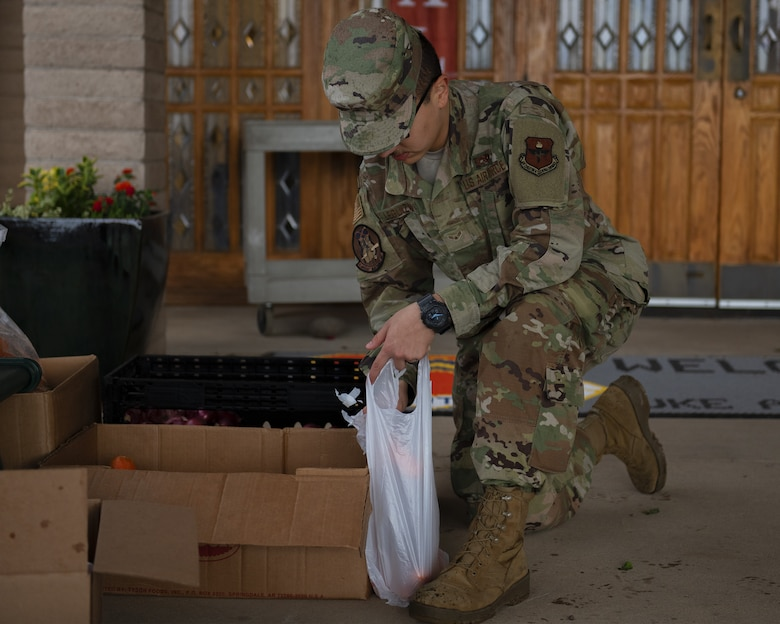 Airman 1st Class Isaac Leguizamo, 61st Aircraft Maintenance Unit avionics technician, volunteers at the annual Turkeys for Troops food drive Nov. 21, 2019, at Luke Air Force Base, Ariz.