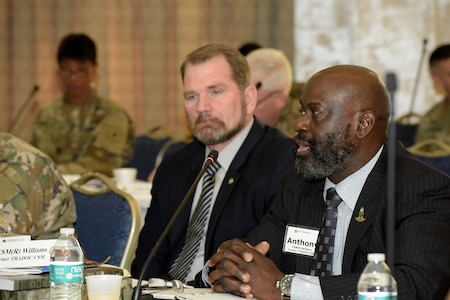 Retired Command Sgt. Maj. Anthony Williams, a former command sergeant major of U.S. Army Training and Doctrine Command, speaks as retired Command Sgt. Maj. John Sparks listens during the TRADOC Senior Leaders Forum held Nov. 19-20, 2019, at Fort Eustis, Va. Williams shared his experience leading the command's effort to redesign the Primary Leadership Development Course and the Sergeants Major Course during his tenure.