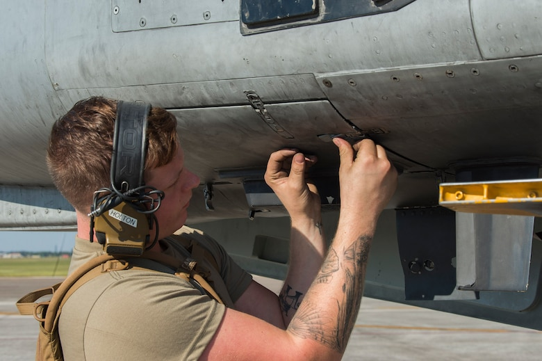 U.S. Air Force Senior Airman Dylan Holton, a weapons load crewmember assigned to the 23rd Aircraft Maintenance Squadron, Moody Air Force Base, Ga., closes a panel on an A-10 Thunderbolt II assigned to the 74th Fighter Squadron, Moody AFB, during Exercise Mobil Tiger Nov. 19, 2019 on MacDill Air Force Base, Fla.