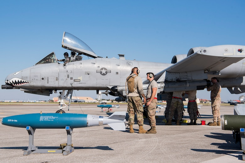 Airmen assigned to the 23rd Aircraft Maintenance Squadron, Moody Air Force Base, Ga., re-configure weapons on an A-10 Thunderbolt II assigned to the 74th Fighter Squadron Moody AFB for Exercise Mobil Tiger Nov. 19, 2019 on MacDill Air Force Base, Fla.