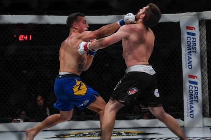 Joshua Lilley, Cage Fury Fighting Championship fighter, punches Nelson Tuckwiller, CFFC fighter during the CFFC 80 at Joint Base Langley-Eustis, Virginia, Nov. 22, 2019.