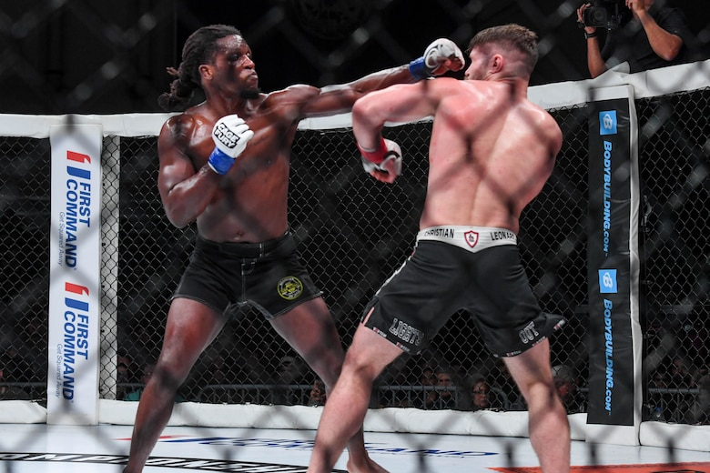 D'Juan Owens, Cage Fury Fighting Championship fighter, punches Christian Leonard, CFFC fighter, during the CFFC 80 at Joint Base Langley-Eustis, Virginia, Nov. 22, 2019.