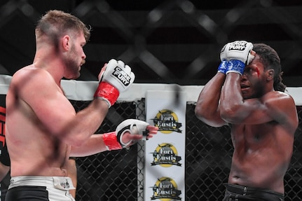 Christian Leonard and D'Juan Owens, Cage Fury Fighting Championship fighters, fight during CFFC 80 at Joint Base Langley-Eustis, Virginia, Nov. 22, 2019.