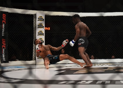 """Will Spann III knocks down Jordan De Jesus during the Cage Fury Fighting Champion 80 """"Fight for Troops"""" event at Joint Base Langley-Eustis, Virginia, Nov. 22, 2019."""
