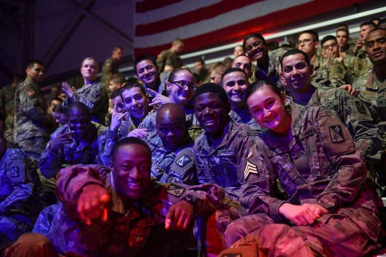 "U.S. Army advanced individual training Soldiers pose for a photos during the Cage Fury Fighting Champion 80 ""Fight for Troops"" event at Joint Base Langley-Eustis, Virginia, Nov. 22, 2019."