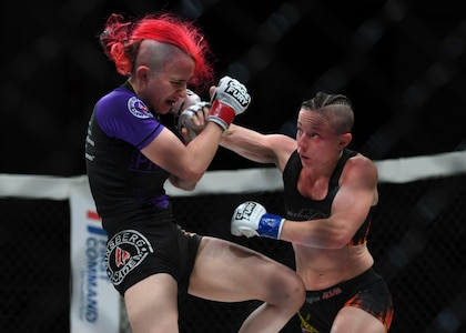 """Jillian DeCoursey punches Katie Perez during the Cage Fury Fighting Champion 80 """"Fight for Troops"""" event at Joint Base Langley-Eustis, Virginia, Nov. 22, 2019."""