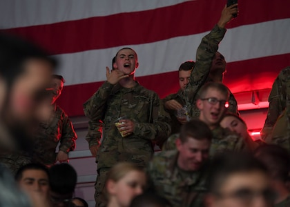 """U.S. Army Soldiers cheer during the Cage Fury Fighting Champion 80 """"Fight for Troops"""" event at Joint Base Langley-Eustis, Virginia, Nov. 22, 2019."""