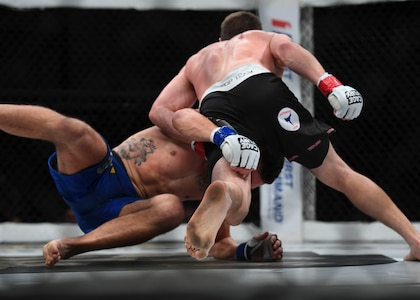 """Nelson Tuckwiller, right, and Joshua Lilley, left, grapple during the Cage Fury Fighting Champion 80 """"Fight for Troops"""" event at Joint Base Langley-Eustis, Virginia, Nov. 22, 2019."""