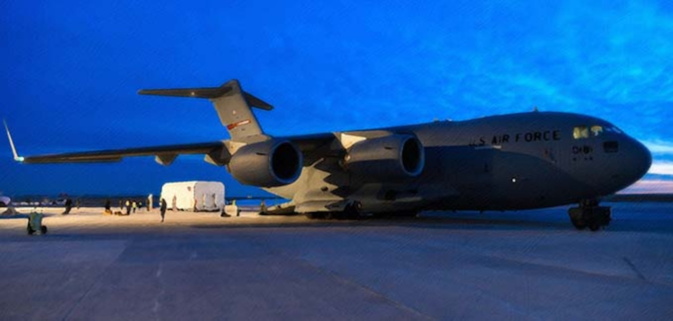 A C-17 Globemaster III sits on a flightline March 19, 2019, on Buckley Air Force Base, CO. Lockheed Martin along with The Air National Guard and active duty components loaded the 70,000 pound cargo, successfully delivering the second GPS III Space Vehicle to Astrotech Space Operations in Titusville, Florida to begin satellite launch processing. (U.S. Air Force photo by Airman 1st Class Michael D. Mathews)