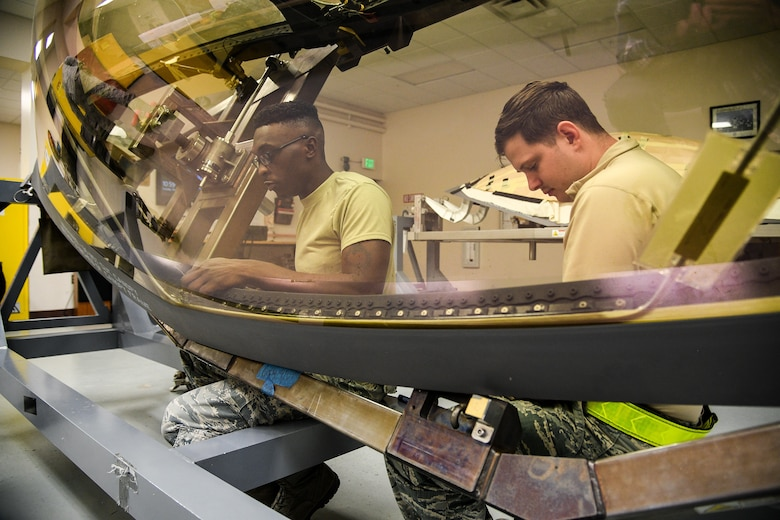 A photo of Airmen working on an F-35A canopy.
