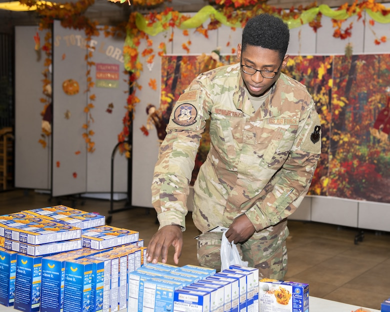 Senior Airman Jaylen McMurtry, 61st Aircraft Maintenance Unit maintainer, picks up boxed goods at the Turkeys for Troops food drive Nov. 21, 2019, at Luke Air Force Base, Ariz.
