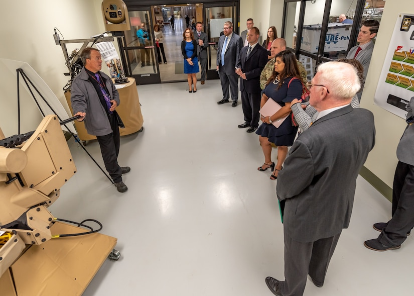 Photo of Dr. Portia Crowe, Chief Data Officer Army Futures Command's Network Cross-Functional Team and Lt. Col. Brandon Baer, Product Manager for Helicopter and Multi-Mission Radios, Project Manager Tactical Radios touring Tobyhanna Army Depot.