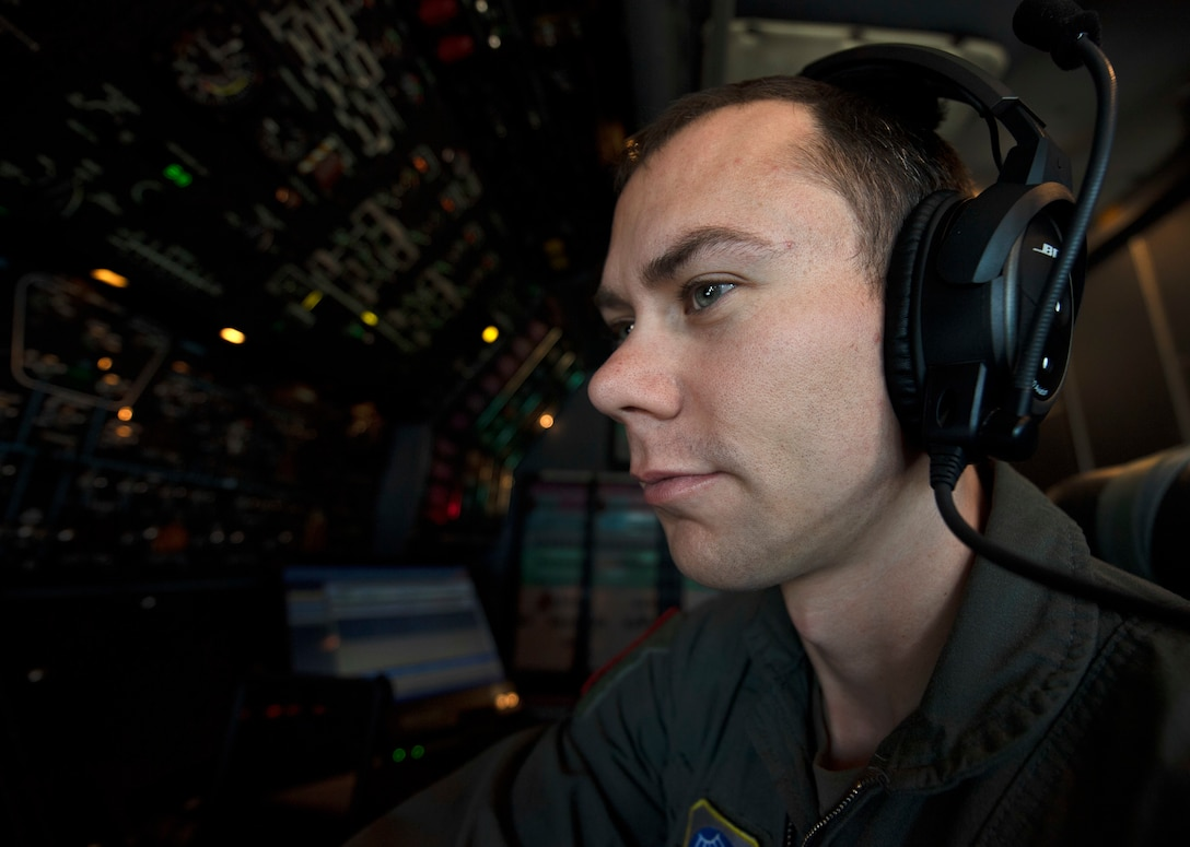 Photos of the 22nd Airlift Squadron preparing for flight.